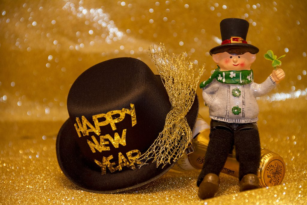 Canva – Black And Gold New Year Hat With Irish Doll Figure